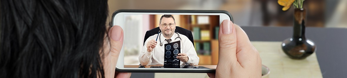 patient talking to doctor on cellphone through telemedicine