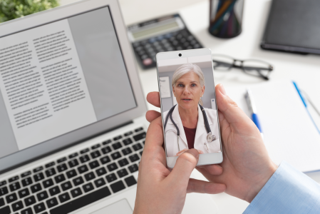 close up of person talking to a doctor through a video call